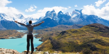 man at mirador condor enjoying hiking and view of cuernos del paine in torres del paine national park, patagonia, chile